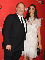Oct. 10, 2017 -  (File Photo) - Movie producer Harvey Weinstein is being accused of sexual harassment allegations, which has led to him being fired. PICTURED: April 24, 2012 - New York, New York, U.S. - HARVEY WEINSTEIN and GEORGINA CHAPMAN attend the 2012 TIME 100 Gala held at the Time Warner Center at Columbus Circle. (Credit Image: © Nancy Kaszerman/ZUMAPRESS.com)