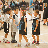 Teams shake hands after a Halo Basketball Game Saturday December 20, 2014 at Grace United Methodist Church in Wilmington, N.C. (Jason A. Frizzelle)