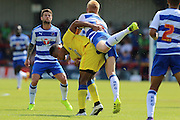 AFC Wimbledon striker Lyle Taylor (33) and Reading FC defender Paul McShane tussle during the Pre-Season Friendly match between AFC Wimbledon and Reading at the Cherry Red Records Stadium, Kingston, England on 23 July 2016. Photo by Stuart Butcher.