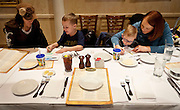 Spencer Nielsen and Carter Davidson, center left and right, enjoy crayons before their meal with their parents, Taryn and Sedra during lunch at BRIO Tuscan Grill in Murray, Friday, Nov. 9, 2012.