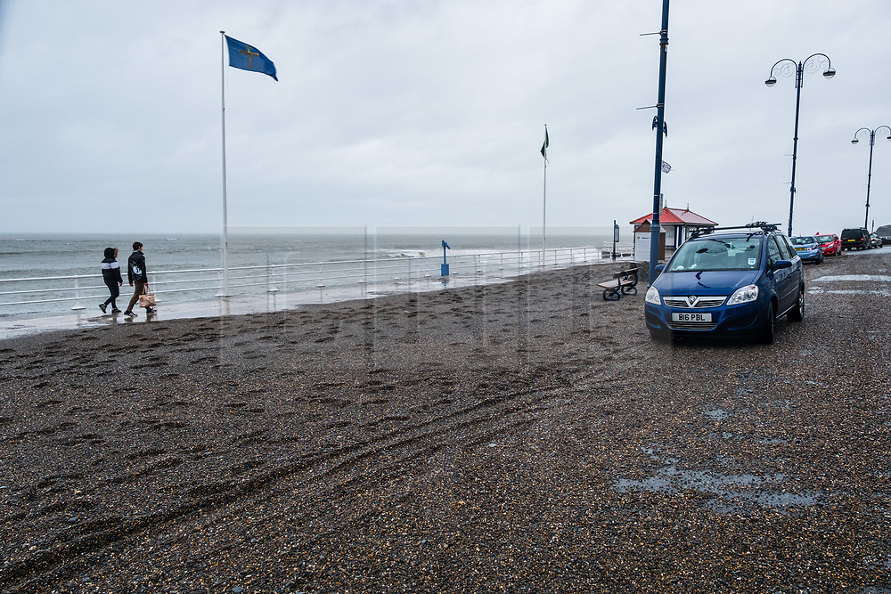 © Licensed to London News Pictures. 13/10/2018. Aberystwyth, UK. After a night of strong winds and high tides associated with Storm Callum, the promenade in Aberystwyth is covered in hundreds of tons of beach sand and gravel. With another high tide this morning, and winds again gusting over 50mph, further damage is likely. Photo credit: Keith Morris/LNP