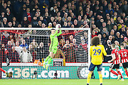 Sheffield United goalkeeper Dean Henderson (1) claims the ball from a Arsenal defender David Luiz (23) free kick during the Premier League match between Sheffield United and Arsenal at Bramall Lane, Sheffield, England on 21 October 2019.