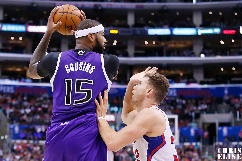 23 November 2013: Los Angeles Clippers power forward Blake Griffin (32) defends on Sacramento Kings center DeMarcus Cousins (15) during the Los Angeles Clippers 103-102 victory over the Sacramento Kings at the Staples Center, Los Angeles, California, USA.