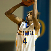 12/03/11 Newark DE: Freshman Guard #4 Jarvis Threatt drains a shot from deep during a Colonial Athletic Association conference basketball game, Saturday, Dec. 03, 2011 at the Bob carpenter center in Newark Delaware...Sophomore Guard #10 Devon Saddler would finish the game with 30 total points, Delaware defeat Drexel 71-60.