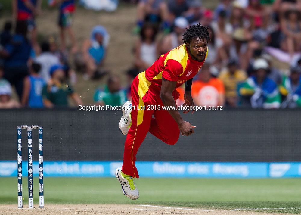 Zimbabwe's Solomon Mire bowling during the ICC Cricket World Cup match - South Africa v Zimbabwe at Seddon Park, Hamilton, New Zealand on Sunday 15 February 2015.  Photo:  Bruce Lim / www.photosport.co.nz
