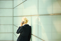 Businesswoman Using Cell Phone back view