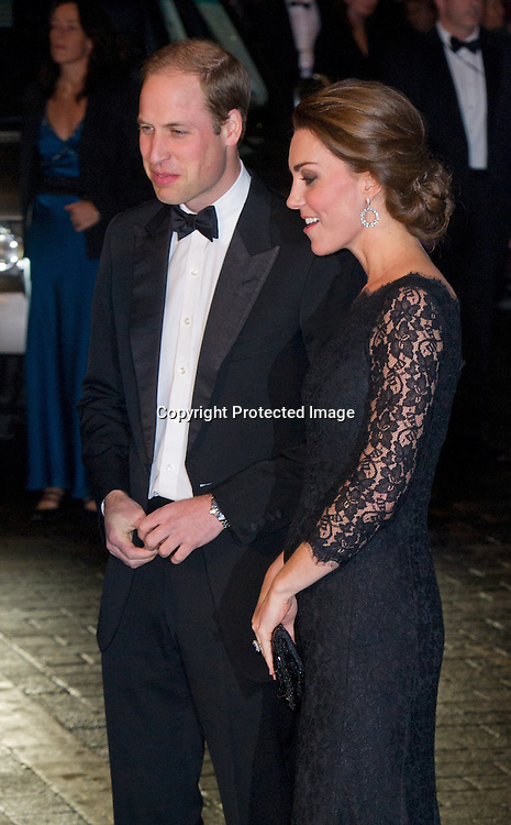 Prince William, Duke of Cambridge and Catherine, Duchess of Cambridge attend The Royal Variety Performance at the London Palladium on November 13, 2014.  The Duchess is wearing a black Diana Von Furstenburg lace gown.