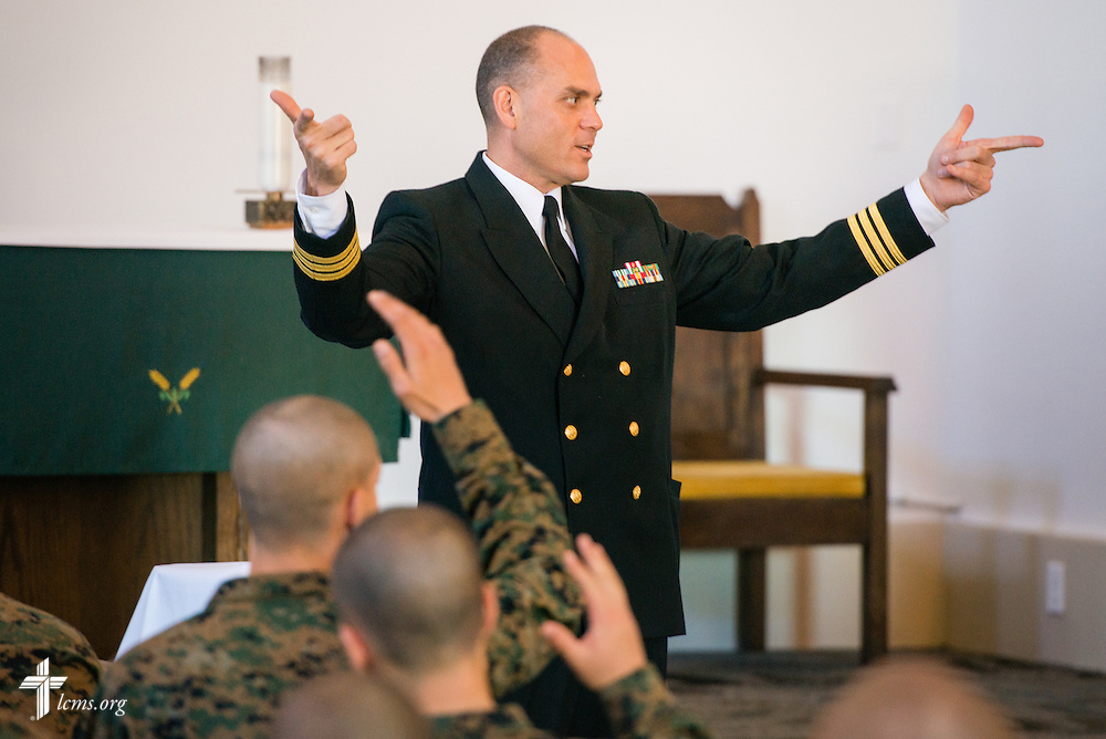 Cmdr. Charles E. Varsogea, chaplain at the Marine Corps Recruit Depot, chats with recruits following Divine Service on Sunday, Feb. 1, 2015, in San Diego, Calif. LCMS Communications/Erik M. Lunsford
