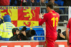 CARDIFF, WALES - Friday, October 12, 2012: Wales' Gareth Bale celebrates scoring the winning second goal against Scotland during the Brazil 2014 FIFA World Cup Qualifying Group A match at the Cardiff City Stadium. (Pic by David Rawcliffe/Propaganda)