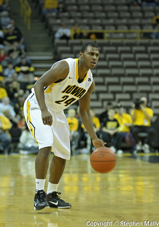 December 04 2010: Iowa Hawkeyes guard Bryce Cartwright (24) brings the ball down court during the first half of their NCAA basketball game at Carver-Hawkeye Arena in Iowa City, Iowa on December 4, 2010. Iowa won 70-53.