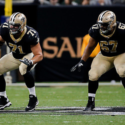 Dec 17, 2017; New Orleans, LA, USA; New Orleans Saints offensive tackle Ryan Ramczyk (71) and offensive guard Larry Warford (67) block during the second quarter against the New York Jets at the Mercedes-Benz Superdome. Warford left the game later in the second quarter after suffering a concussion and did not return to action. Mandatory Credit: Derick E. Hingle-USA TODAY Sports