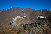 The ancient Great Wall of China snaking through mountains at Mutianyu, north of Beijing (formerly Peking)