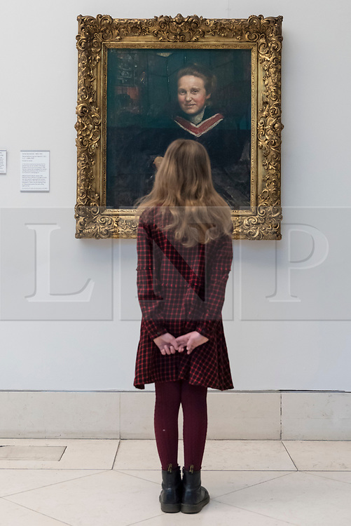 © Licensed to London News Pictures. 02/02/2018. LONDON, UK.  Stella Cartwright, aged 9, views a portrait of Millicent Fawcett, by Annie Swynnerton, on display at Tate Britain to mark the centenary of the women's right to vote, as embodied in the Representation of the People Act.  Millicent Fawcett was a leading figure in the suffragist movement, campaigning for the right for women to vote in the UK, while Annie Swynnerton was one of the first women elected to be a member of the Royal Academy of Arts.  Photo credit: Stephen Chung/LNP
