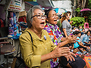 03 SEPTEMBER 2016 - BANGKOK, THAILAND:   Bangkok residents who support the people in Pom Mahakan Fort sing Thai folk songs during a stand off with Bangkok city officials. Hundreds of people from the Pom Mahakan community and other communities in Bangkok barricaded themselves in the Pom Mahakan Fort to prevent Bangkok officials from tearing down the homes in the community Saturday. The city had issued eviction notices and said they would reclaim the land in the historic fort from the community. People prevented the city workers from getting into the fort. After negotiations with community leaders, Bangkok officials were allowed to tear down 12 homes that had either been abandoned or whose owners had agreed to move. The remaining 44 families who live in the fort have vowed to stay.     PHOTO BY JACK KURTZ