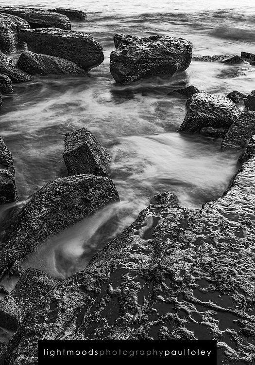 Waves washing over the rocky shoreline of Black Head, Gerroa, South Coast, NSW, Australia