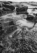 Waves washing over the rocky shoreline of Black Head, Gerroa, South Coast, NSW, Australia