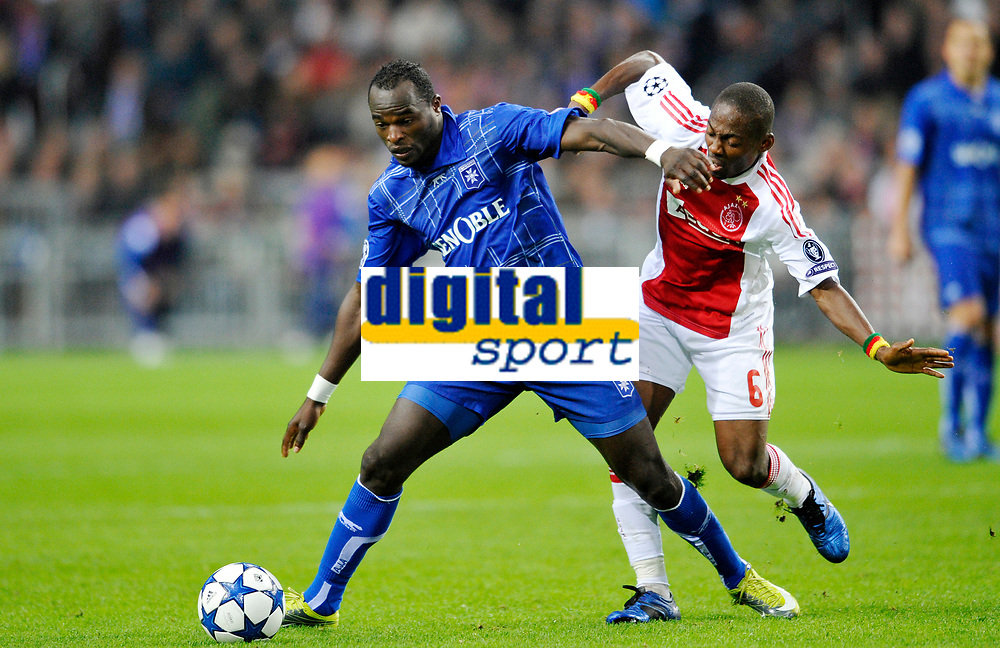 FOOTBALL - CHAMPIONS LEAGUE 2010/2011 - GROUP STAGE - GROUP G - AJAX AMSTERDAM v AJ AUXERRE - 19/10/2010 - PHOTO GUY JEFFROY / DPPI - DENNIS OLIECH (AUX) / EYONG ENOH (AJAX)