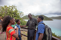 "Glen Kwabena Davis, center, congratulates storytellers Yohancé Henley (right) and apprentices Jikelle Michaels and Alikai Fleming-Haywood.  The Virgin Islands National Park Service presents the 26th Annual Folk-life Festival ""Celebrating Transfer Day from the Danish West Indies to the United States Virgin Islands""  Annaberg Sugar Plantation Ruins.  23 February 2017.  © Aisha-Zakiya Boyd"
