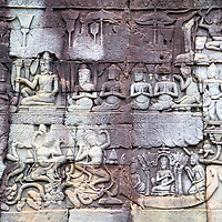 Dancing Apsaras at Bayon in Angkor Archaeological Park, Cambodia<br /> Within Bayon&rsquo;s third enclosure are several galleries displaying elaborate bas-reliefs. This carving represents the king in his royal court. His majesty is surrounded by celestial dancing nymphs from Hindu mythology called apsaras. Other scenes depicted in the temple include battles, the royal palace and everyday life.