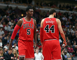 December 18, 2017 - Chicago, IL, USA - Chicago Bulls forward Bobby Portis (5) and Chicago Bulls forward Nikola Mirotic (44) teamed up during the first half of an NBA basketball game against the Philadelphia 76ers at the United Center in Chicago on Monday, Dec. 18, 2017. The Bulls won, 117-115. (Credit Image: © Terrence Antonio James/TNS via ZUMA Wire)