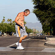"""I believe in the power of the human spirit to overcome anything"", says Frank Zak, 60, who walks twice a day, every day, around his midtown neighborhood in Tucson, Arizona.  Zak sustained major injuries in 1982 when his motorcycle was struck by a drunk driver and he was paralyzed and was injured again in another accident with a truck in 2003 where his neck was broken.  ""It is amazing how many people are supportive.  There is still a lot of good people out there--I am really encouraged by that"", he added about people he encounters along the way."