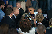President Obama is photographed with an iPad while he shakes hands following a rally at Ohio University in Athens, Ohio.