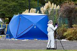 © Licensed to London News Pictures. 22/09/2019. SLOUGH, UK.  A forensics team member near one of two forensics tents at Salt Hill Park in Slough, Berkshire, where it is reported a 15 year old boy was fatally stabbed after an altercation with another male.  Emergency services attended the scene at 6.30pm on the evening of 21 September where the boy was pronounced dead.  Investigations are ongoing.  Photo credit: Stephen Chung/LNP