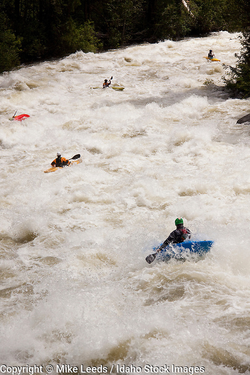 """Mike McKee, James Byrd, Sam, Fred Coriel, and Tristan McLaran in """"Screaming Left Turn"""" on the North Fork Payette River, Idaho. 7,000-8,000cfs"""