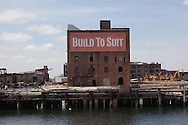 New York. brooklyn. Red Hook . the old docks area under renovation. are suposed to become a trendy area, old destroyed factories  New York, - United states  / le quartier de Red Hook . Brooklyn , les anciens docks au bord de la mer se transforment en quartier a la mode. , New York - Etats unis