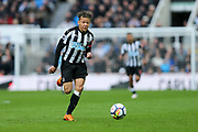 Dwight Gayle (#9) of Newcastle United chases after a through ball from Jonjo Shelvey (#8) of Newcastle United during the Premier League match between Newcastle United and Huddersfield Town at St. James's Park, Newcastle, England on 31 March 2018. Picture by Craig Doyle.