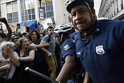 Philadelphia Police officers clear the path of a government vehicle, driven by Unites States Secret Service agents, during a protest as Vice President Mike Pence is visiting an event organized by Republican Governors Association (RGA) at a Rittenhouse Square hotel, in Philadelphia, PA, on June 19, 2018.