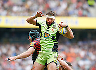 Tom Wood of Northampton Saints wins a lineout from Mouritz Botha of Saracens during the Aviva Premiership final at Twickenham Stadium, Twickenham<br /> Picture by Andrew Tobin/Focus Images Ltd +44 7710 761829<br /> 31/05/2014