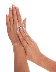 applying cream to hands