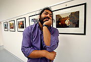 Mario in front of his photographs during an exhibition opening in Ostrava. Mario is a well known blind Roma musician originally from Slovakia living since he finished his studies in Prague, Czech Republic. Beside being a very talented multi-instrumentalist working as a professional musician he is also experimenting with photography as a another way to express himself.