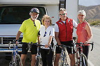 Two Senior couples with bikes on road