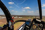 Nederland, Drenthe, Eelde, 01-05-2013; Groningen Airport Eelde, take-off. Helikopter met fotograaf stijgt en verlaat Airport Eelde.<br /> Helicopter leaves Airport Eelde.<br /> luchtfoto (toeslag op standard tarieven)<br /> aerial photo (additional fee required)<br /> copyright foto/photo Siebe Swart