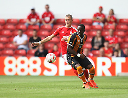 Thomas Lam on Nottingham Forest (L) and Adama Diomande of Hull City in action - Mandatory by-line: Jack Phillips/JMP - 30/07/2016 - FOOTBALL - The City Ground - Nottingham, England - Nottingham Forest v Hull City - Pre-Season Friendly