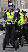 CENTRAL LONDON. Lembit Optik MP and fellow Segway supporters return from handing in a document from the Dept of Transport calling on the Govt to approve Segway use on cycle facilities and public roads in 2010. Currently they are illegal on public roads. 13 June 2010. STEPHEN SIMPSON..