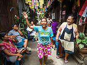 15 AUGUST 2016 - BANGKOK, THAILAND: Women who live in the Pom Mahakan slum shout at Bangkok city officials who put up eviction notices around the slum. Final eviction notices were posted today and residents of the slum have been told they must leave the fort by September 3, 2016. The Pom Mahakan community is known for fireworks, fighting cocks and bird cages. Mahakan Fort was built in 1783 during the reign of Siamese King Rama I. It was one of 14 fortresses designed to protect Bangkok from foreign invaders. Only two of the forts are still standing, the others have been torn down. A community developed in the fort when people started building houses and moving into it during the reign of King Rama V (1868-1910). The land was expropriated by Bangkok city government in 1992, but the people living in the fort refused to move. In 2004 courts ruled against the residents and said the city could take the land.      PHOTO BY JACK KURTZ
