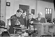 21/02/1963.02/21/1963.21 February 1963.Teachers tour Bord na Mona workshops. Vocational school teachers, whose past pupils include Bord na Mona apprntices, were guests at three of the Board's workshops, to study the organisation of the workshops and watch apprntices on the job. Teachers Tom Wright (Ferbane Vocational School) and Peter Heery (Edenderry V.S.) and C.T. Mullally, Department of Education stop to talk with Senior Apprentice Kevin Whelehan at work on a lade at Derrygreenagh milled peat-works, Co. Offaly.