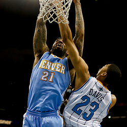 Mar 25, 2013; New Orleans, LA, USA; Denver Nuggets shooting guard Wilson Chandler (21) dunks over New Orleans Hornets power forward Anthony Davis (23) during the second half of a game at the New Orleans Arena. The Hornets defeated the Nuggets 110-86. Mandatory Credit: Derick E. Hingle-USA TODAY Sports