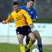 St Johnstone v Raith Rovers...24.01.04<br />John Sutton is blocked by Ian Maxwell<br /><br />Picture by Graeme Hart.<br />Copyright Perthshire Picture Agency<br />Tel: 01738 623350  Mobile: 07990 594431