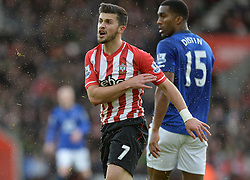 Southampton's Shane Long shows his frustration as he is sent tumbling by Everton's Sylvain Distin - Photo mandatory by-line: Alex James/JMP - Mobile: 07966 386802 - 20/12/2014 - SPORT - Football - Southampton  - St Mary's Stadium - Southampton  v Everton - Football