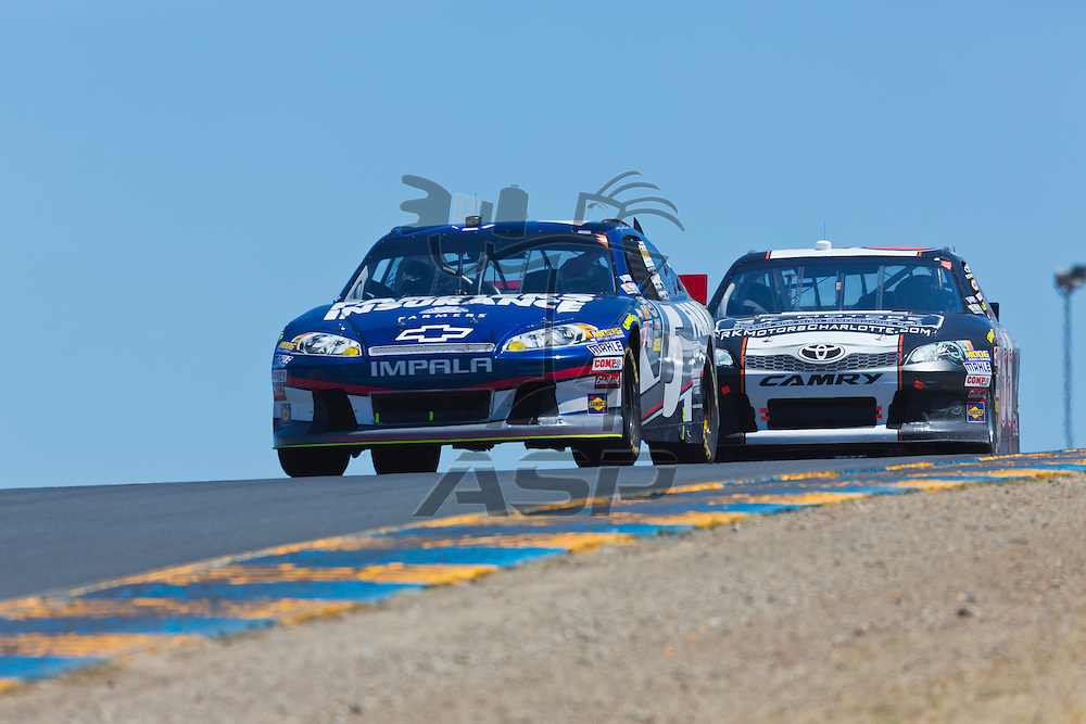 SONOMA, CA - JUN 24, 2012:  Kasey Kahne (5) brings his car through the turns during the Toyota Save Mart 350 at the Raceway at Sonoma in Sonoma, CA.