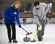 Carol Della Villa and Tim Stames sweep a shot during a match at Rochester Curling Club on Sunday, February 8, 2015.