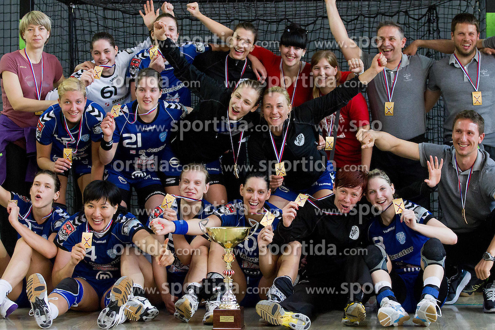 Team of Krim celebrate after the last game of 1st A Slovenian Women Handball League season 2011/12 between ZRK Krka and RK Krim Mercator, on May 8, 2012 in Stopice at Novo mesto, Slovenia. RK Krim Mercator became Slovenian National Champion, GEN-I Zagorje placed second and ZRK Krka placed third. (Photo by Vid Ponikvar / Sportida.com)