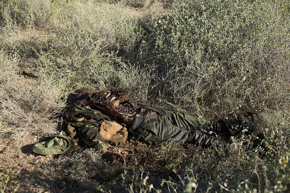The body of a police officer lies decomposing on the ground days after a group of Turkana men ambushed a platoon of officers looking for them.