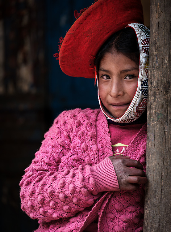 OLLANTAYTAMBO, PERU - CIRCA SEPTEMBER 2019:  Portrait of kid from the andean community of Willoq close to Ollantaytambo in the Sacred Valley of Peru.