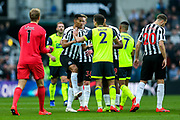 Tommy Smith (#2) of Huddersfield Town protests with Isaac Hayden (#14) of Newcastle United after being issued a red card for a challenge on Miguel Almiron (#24) of Newcastle United during the Premier League match between Newcastle United and Huddersfield Town at St. James's Park, Newcastle, England on 23 February 2019.
