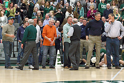 21 February 2015:  Dennie Bridges and Richard Wilson shake hands with former players who have created a reception line ringing half the court along the out of bounds lines.  At half time of an NCAA D# CCIW men's basketball game between the Illinois Wesleyan Titans in Shirk Center, Bloomington IL the floor was named in honor of retiring Dennie Bridges.  Dennie Bridges has been on the job at IWU for 51 years as a basketball coach, then athletic director.  Dennie is the 2nd winningest D3 coach by wins behind only Dick Saurs.  Dennie took the Titans to the D3 NCAA tournament 14 times in 18 season. He had a league record of 421-129 in 17 seasons.  Jack Sikma was a part of Dennie's 1973 recruiting class.  Sikma later played for the Milwaukee Bucks and Seattle Supersonics in the NBA.  IWU President Richard Wilson presided over the ceremony.
